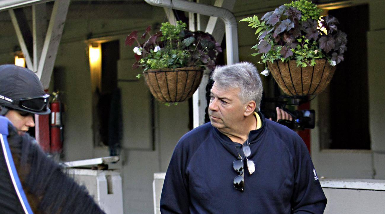 Thoroughbred owner Phil Birsh talks to exercise rider Blair Golen, left, as she grazes Wake Up In Malibu outside Barn 42 at Churchill Downs in Louisville, Ky., Wednesday, April 29, 2015. Birsh owns Kentucky Derby hopeful Tencendur, which Golen handles for