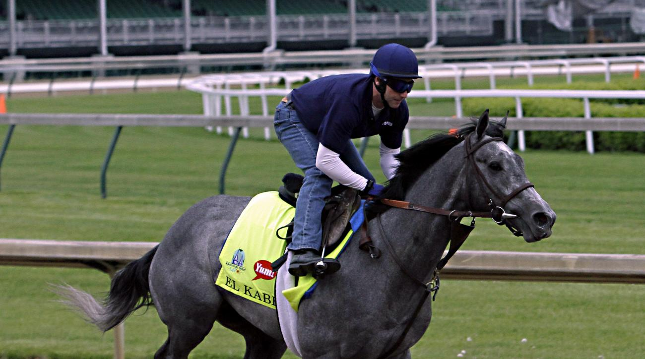 Exercise rider Simon Harris gallops Kentucky Derby entrant El Kabeir at Churchill Downs in Louisville, Ky., Thursday, April 30, 2015. Three-time Kentucky Derby winning jockey Calvin Borel has the mount on Saturday. (AP Photo/Garry Jones)