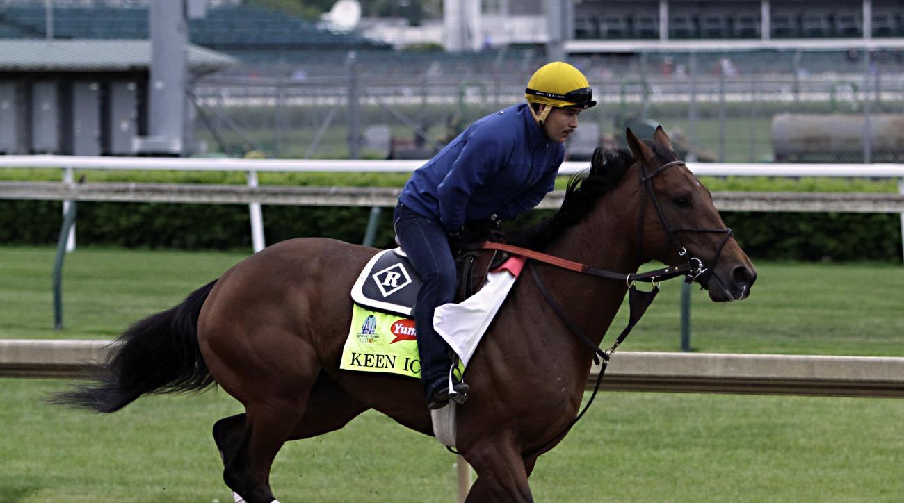 Kentucky Derby entrant Keen Ice gallops at Churchill Downs in Louisville, Ky., Thursday, April 30, 2015 with exercise rider Faustino Aguilar in the saddle.  (AP Photo/Garry Jones)