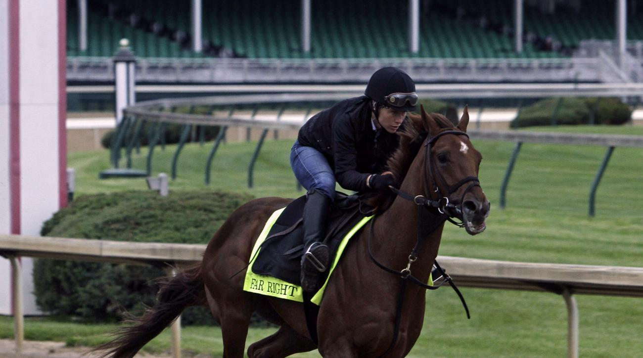 Exercise rider Laura Moquett gallops Kentucky Derby entrant Far Right for trainer husband, Ron Moquett, at Churchill Downs in Louisville, Ky., Thursday, April 30, 2015.  (AP Photo/Garry Jones)