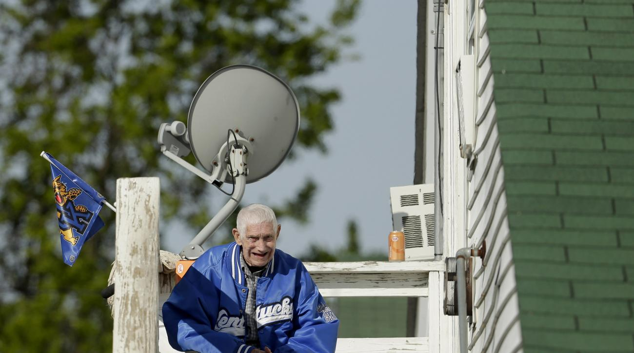 Richard Miller talks to a cat while sitting on the landing outside his room at the Greg Foley Racing Stables barn at Churchill Downs Monday, April 27, 2015, in Louisville, Ky. Miller, who worked for 30 years as a hot walker for Foley has since retired and