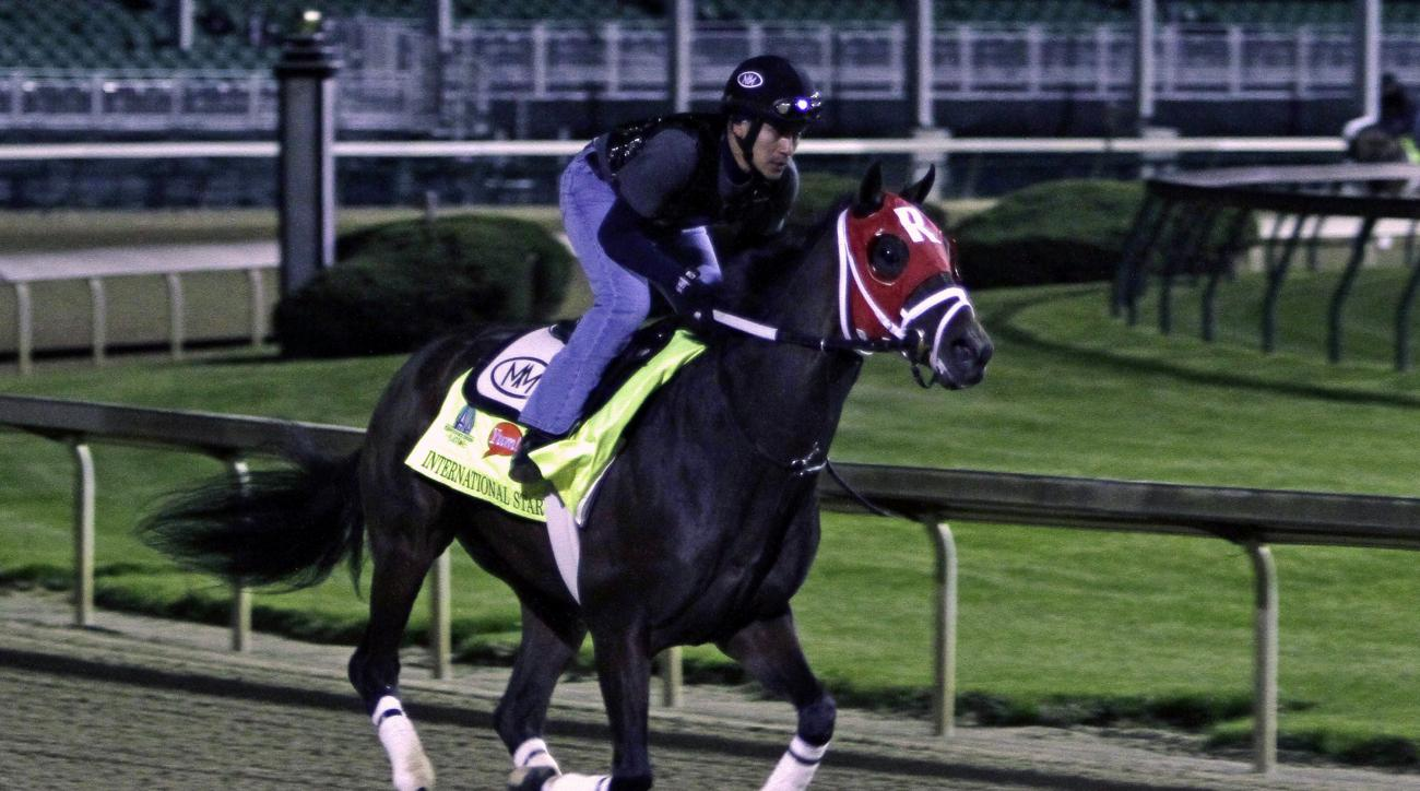 Kentucky Derby entrant International Star, ridden by exercise rider Joel Barrientos, gallops at Churchill Downs in Louisville, Ky., Friday, May 1, 2015.  (AP Photo/Garry Jones)