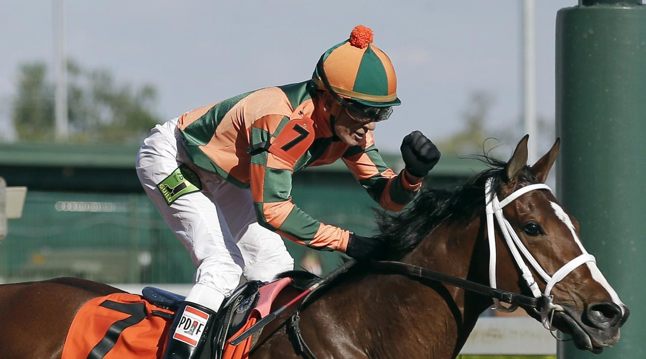 Kerwin D. Clark rides Lovely Maria to victory during the 141st running of the Kentucky Oaks horse race at Churchill Downs Friday, May 1, 2015, in Louisville, Ky. (AP Photo/Brynn Anderson)