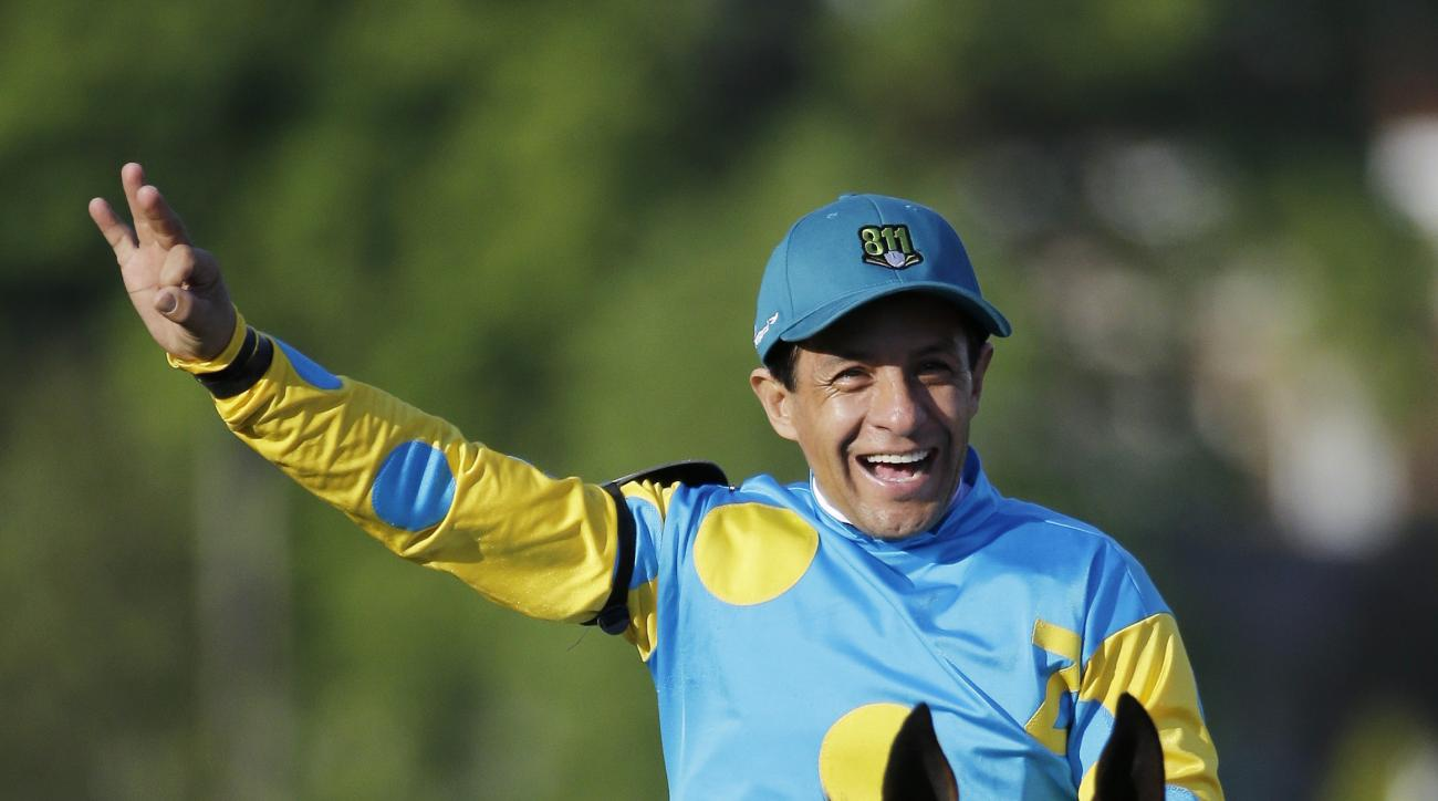 Victor Espinoza reacts after riding American Pharoah to victory in the 141st running of the Kentucky Derby horse race at Churchill Downs Saturday, May 2, 2015, in Louisville, Ky.  (AP Photo/Matt Slocum)