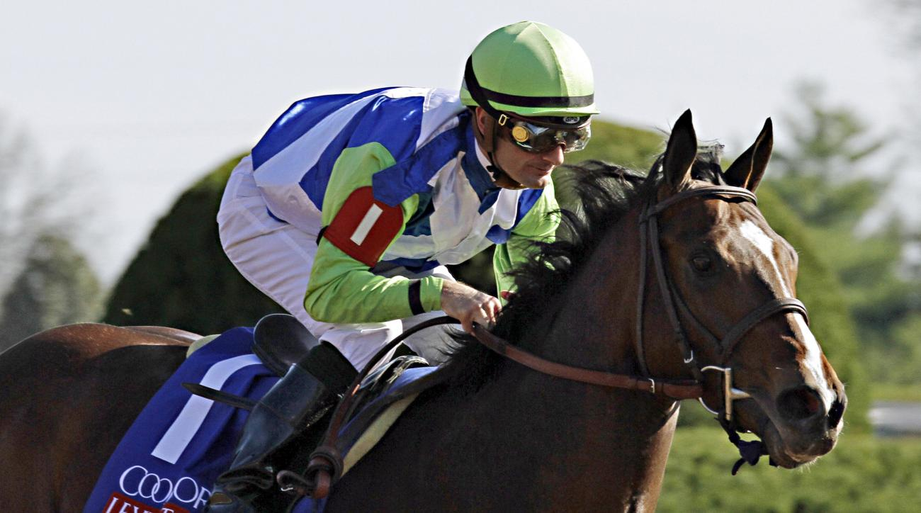 FILE - In this April 11, 2015, file photo, jockey Julien Leparoux rides Divining Rod to a three-length victory in the Lexington Stakes horse race at Keeneland in Lexington, Ky. Roy and Gretchen Jackson look forward to what Divining Rod may achieve, as the