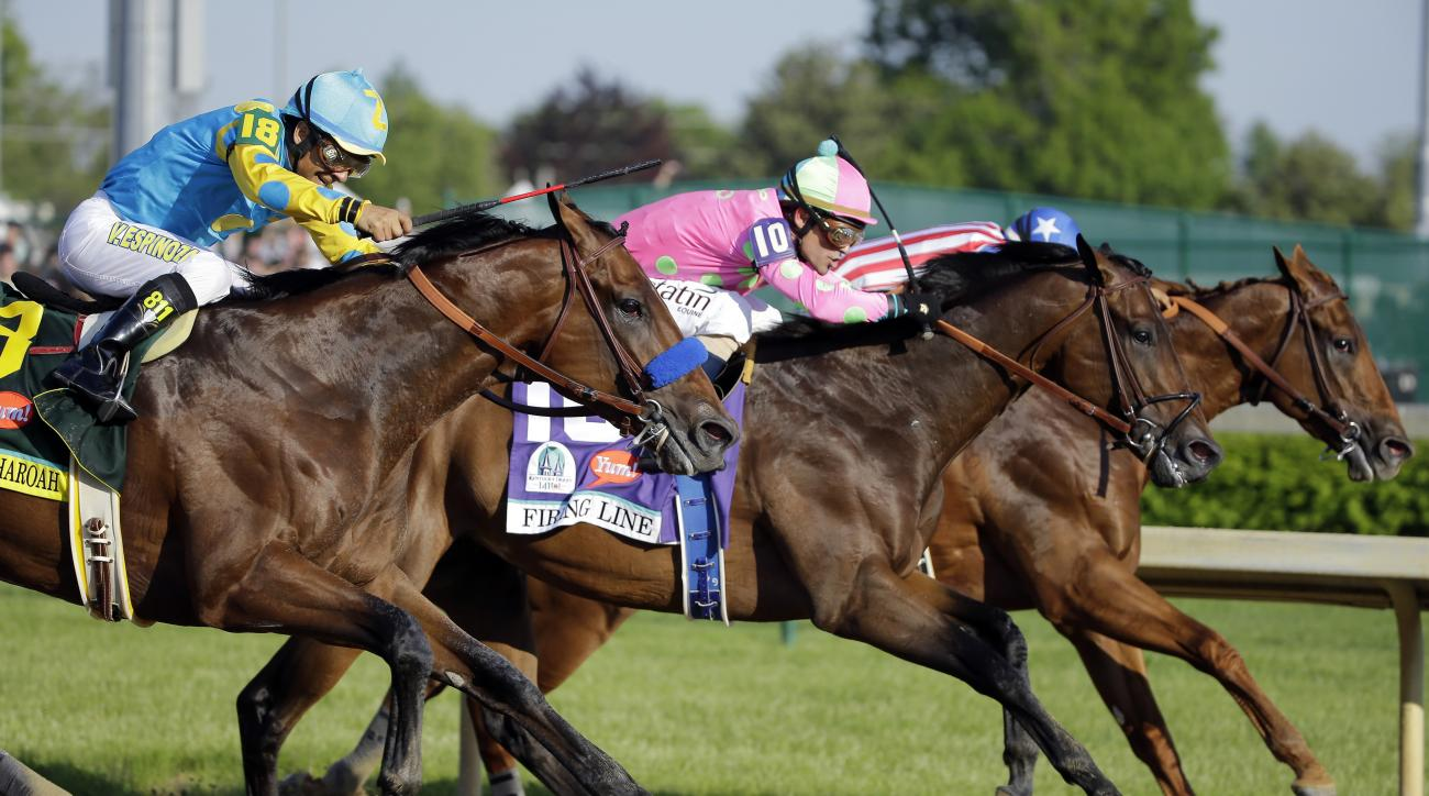 FILE - In this photo taken Saturday, May 2, 2015,  jockey Gary Stevens (10) and Firing Line, lead eventual winner American Pharoah, ridden by Victor Espinoza, left, during the 141st running of the Kentucky Derby horse race at Churchill Downs in Louisville