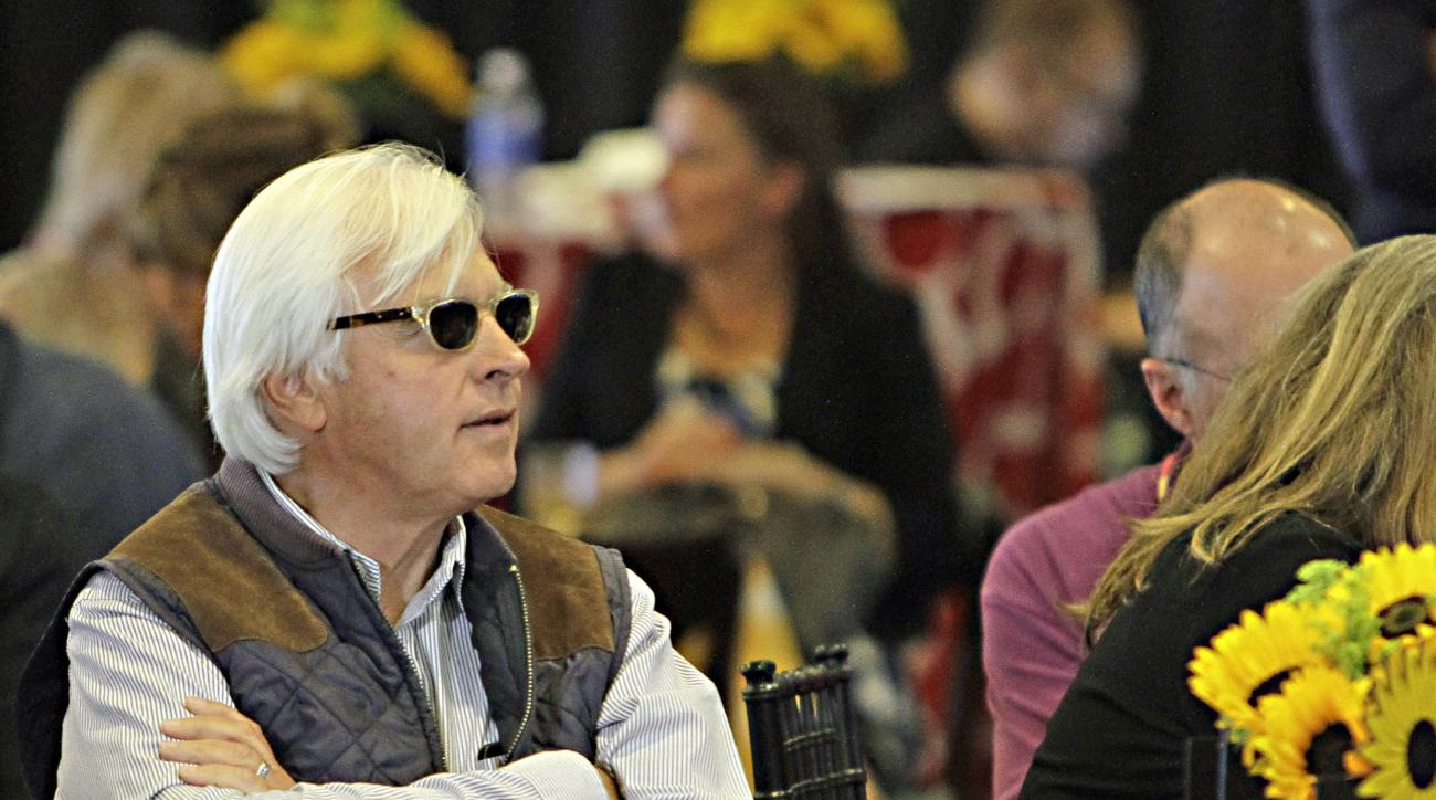 Trainer Bob Baffert, who has both American Pharoah and Dortmund in the field for the 140th Preakness Stakes, watches the draw at Pimlico Race Course in Baltimore, Wednesday, May 13, 2015.  (AP Photo/Garry Jones)