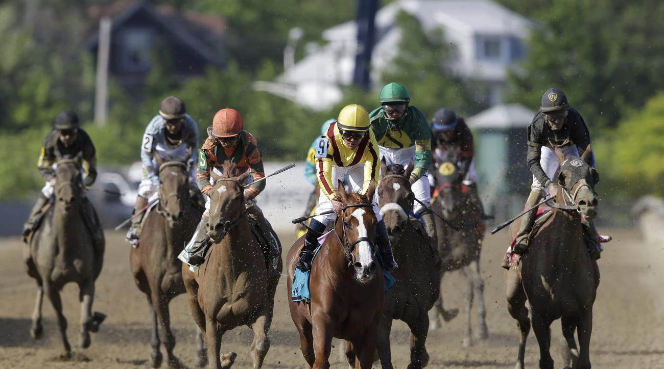 Javier Castellano rides Keen Pauline to a win during the Black-Eyed Susan horse race at Pimlico Race Course, Friday, May 15, 2015, in Baltimore. The 140th Preakness horse race takes place Saturday. (AP Photo/Patrick Semansky)