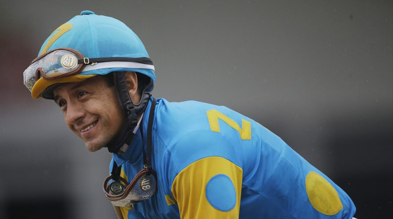 Jockey Victor Espinoza celebrates aboard American Pharoah after winning the 140th Preakness Stakes horse race at Pimlico Race Course, Saturday, May 16, 2015, in Baltimore. (AP Photo/Patrick Semansky)