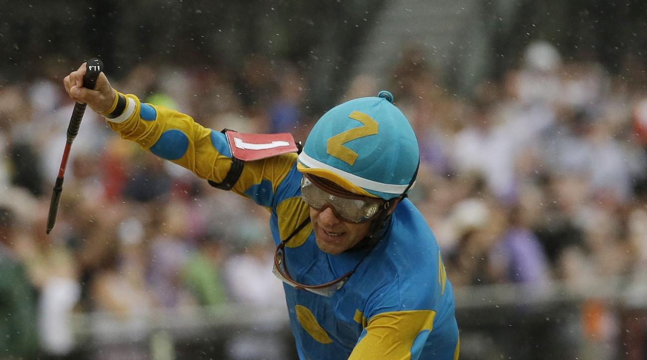 American Pharoah, ridden by Victor Espinoza  wins the 140th Preakness Stakes horse race at Pimlico Race Course, Saturday, May 16, 2015, in Baltimore. (AP Photo/Matt Slocum)