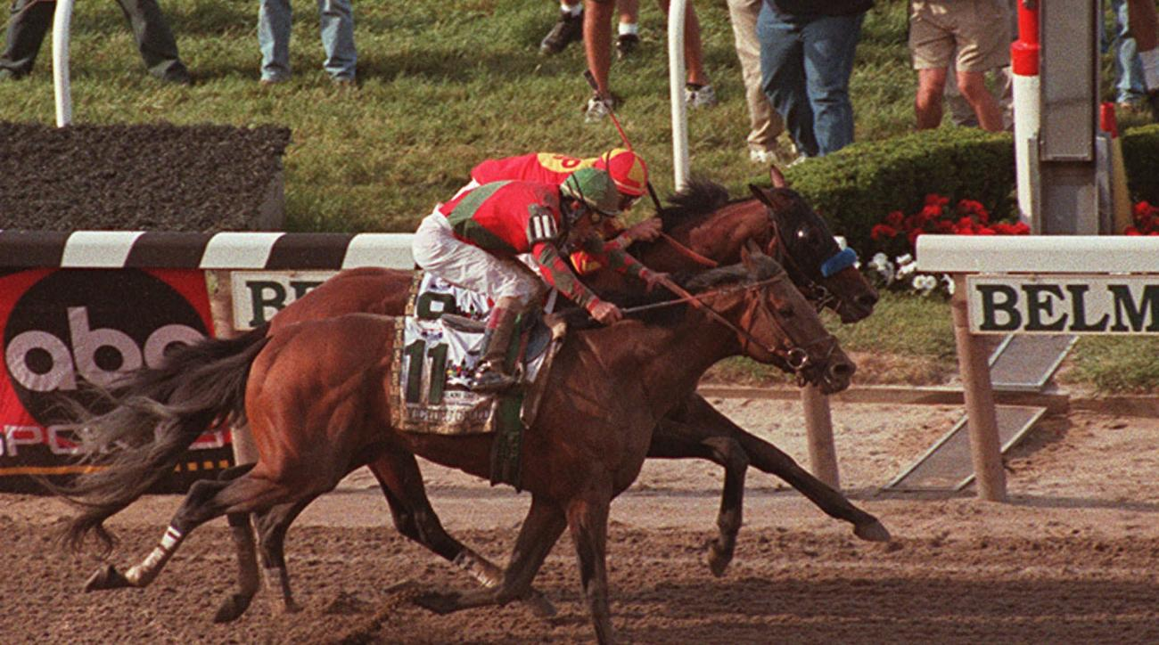 ADVANCE FOR WEEKEND EDITIONS, MAY 23-24 - FILE - In this June 6, 1998, file photo, Victory Gallop (11), with Gary Stevens up, edges out Real Quiet, with Kent Desormeaux up, as they cross the finish line in the 130th running of the Belmont Stakes at Belmon