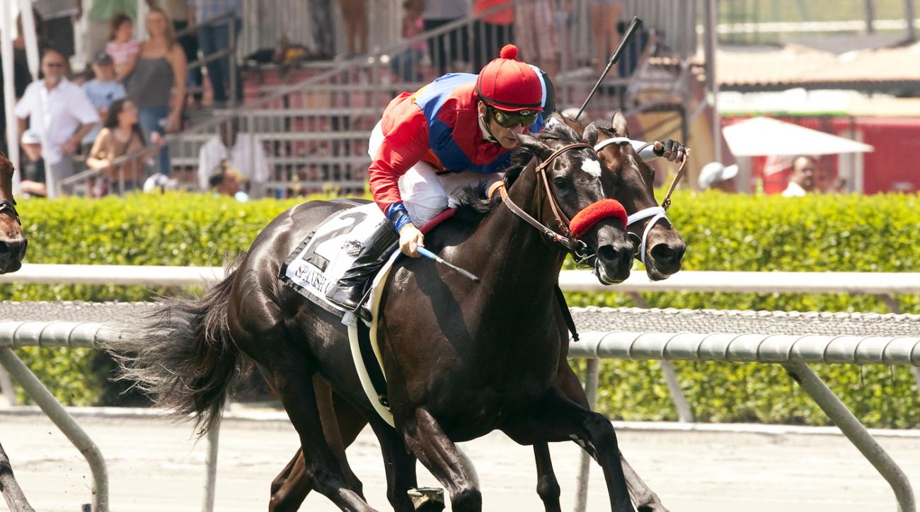 In a photo provided by Benoit Photo, Spanish Queen and jockey Brice Blanc, outside, overtake Feathered and jockey Tyler Baze in mid-stretch to win the Grade I $400,000 American Oaks horse race Saturday, May 30, 2015, at Santa Anita in Arcadia, Calif. (Ben