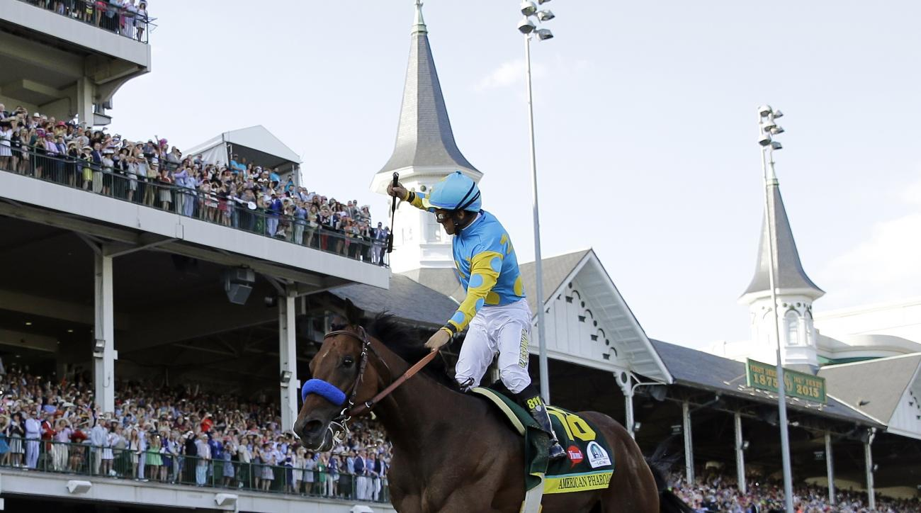 FILE - In this May 2, 2015 file photo, jockey Victor Espinoza celebrates aboard American Pharoah after winning the 141st running of the Kentucky Derby horse race at Churchill Downs in Louisville, Ky.  (AP Photo/David J. Phillip, File)