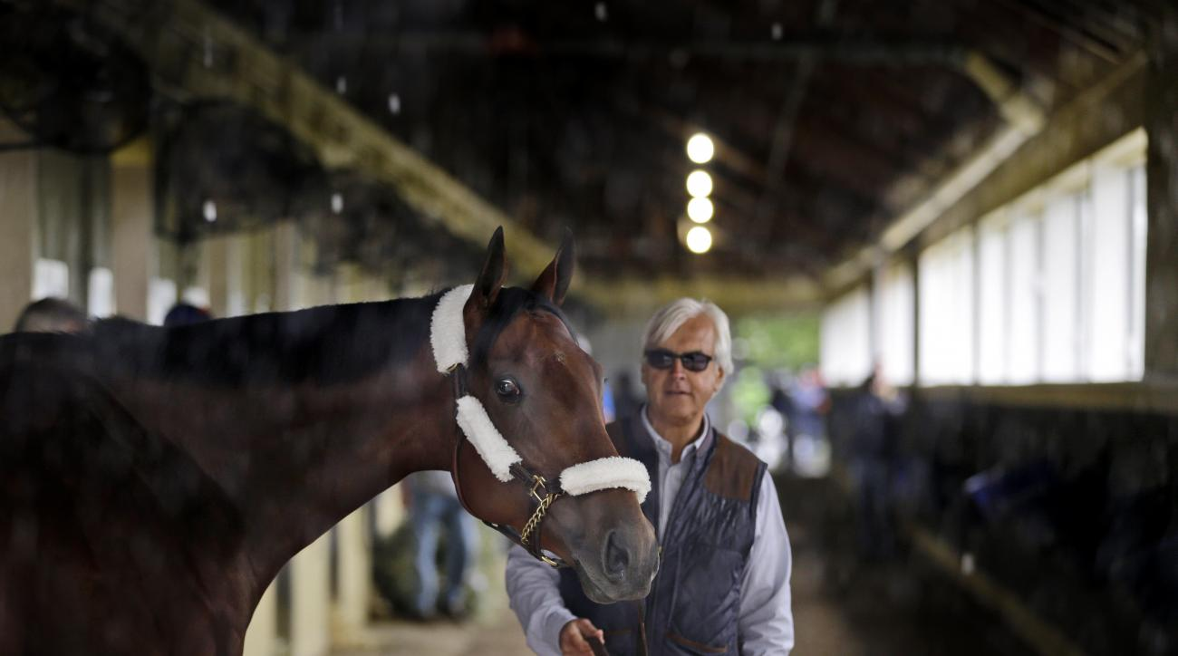 FILE - In this Tuesday, June 2, 2015, file photo, Kentucky Derby and Preakness Stakes winner American Pharoah pauses as he is led around the barn by trainer Bob Baffert after arriving at Belmont Park in Elmont, N.Y. American Pharoah will try to become hor