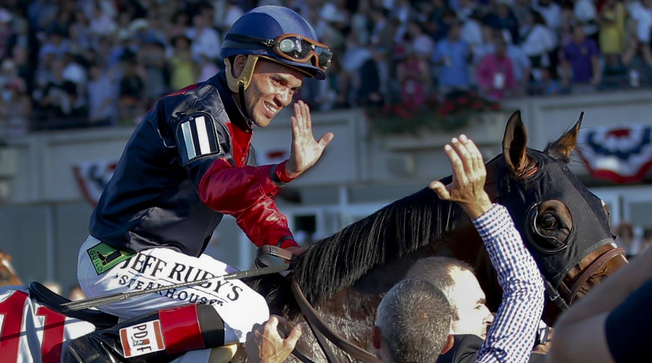 """FILE- In this June 7, 2014, file photo, jockey Joel Rosario, atop Tonalist, celebrates after they won the Belmont Stakes horse race in New York. """"I got lucky ... you need to have a clear trip. You need to get a position and if you are good enough you will"""