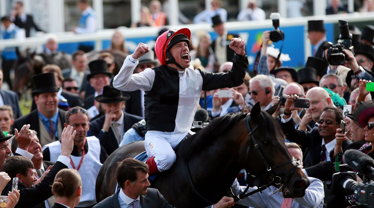 Frankie Dettori celebrates his victory in the English Derby on Golden Horn at Epsom Racecourse, England, Saturday June 6, 2015. (David Davies/PA via AP) UNITED KINGDOM OUT  NO SALES  NO ARCHIVE