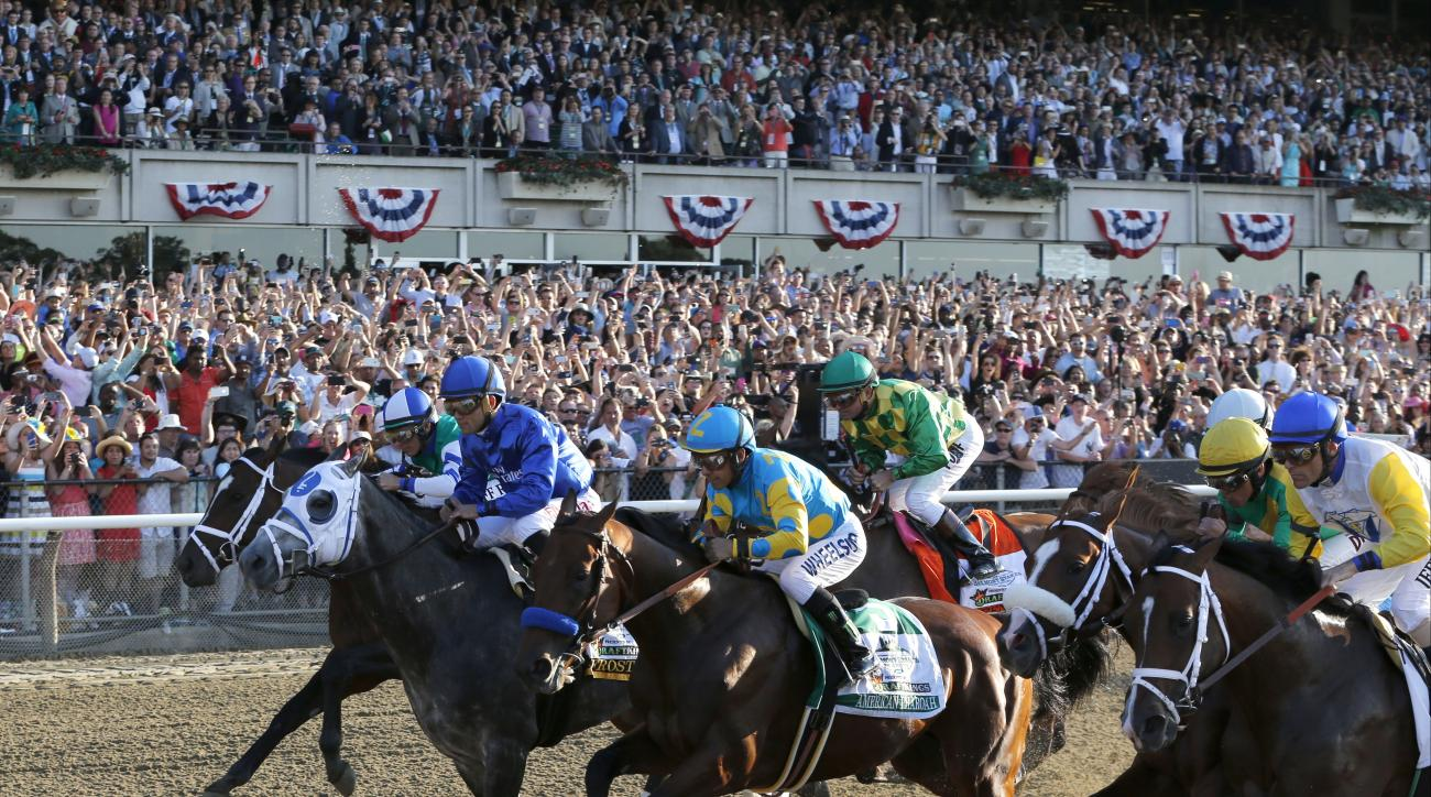 American Pharoah (5) with jockey Victor Espinoza up breaks out of the starting gate at the start of the 147th running of the Belmont Stakes horse race at Belmont Park, Saturday, June 6, 2015, in Elmont, N.Y. American Pharoah won the race to become the fir