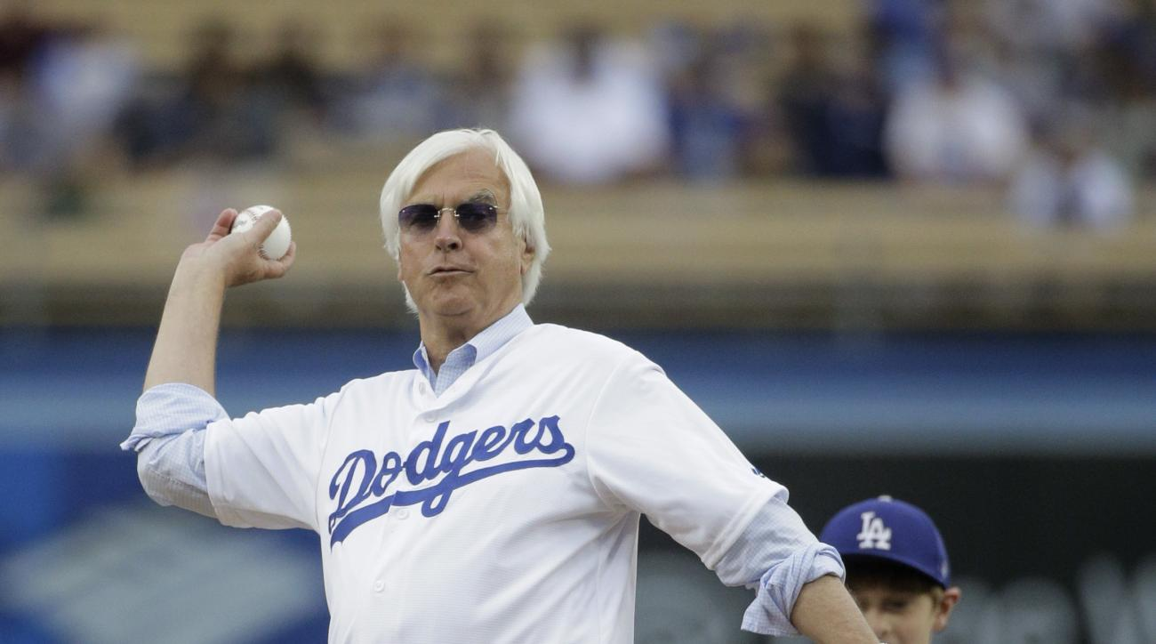 Hall of Fame thoroughbred trainer and Triple Crown winner Bob Baffert throws the ceremonial first pitch before a baseball game between the Los Angeles Dodgers and the Arizona Diamondbacks, Tuesday, June 9, 2015, in Los Angeles. (AP Photo/Jae C. Hong)