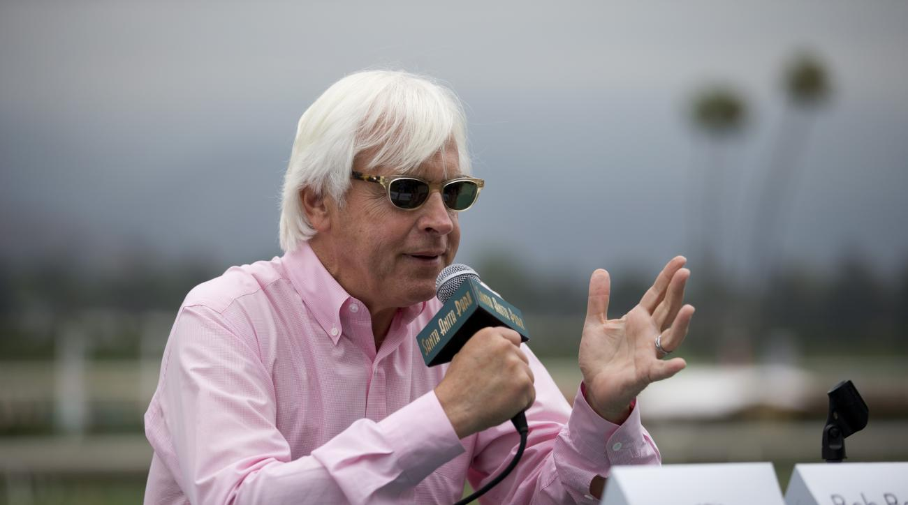 Bob Baffert, the trainer for Triple Crown-winning horse American Pharoah, talks to reporters during a news conference at Santa Anita Park, Wednesday, June 10, 2015, in Arcadia, Calif. (AP Photo/Jae C. Hong)
