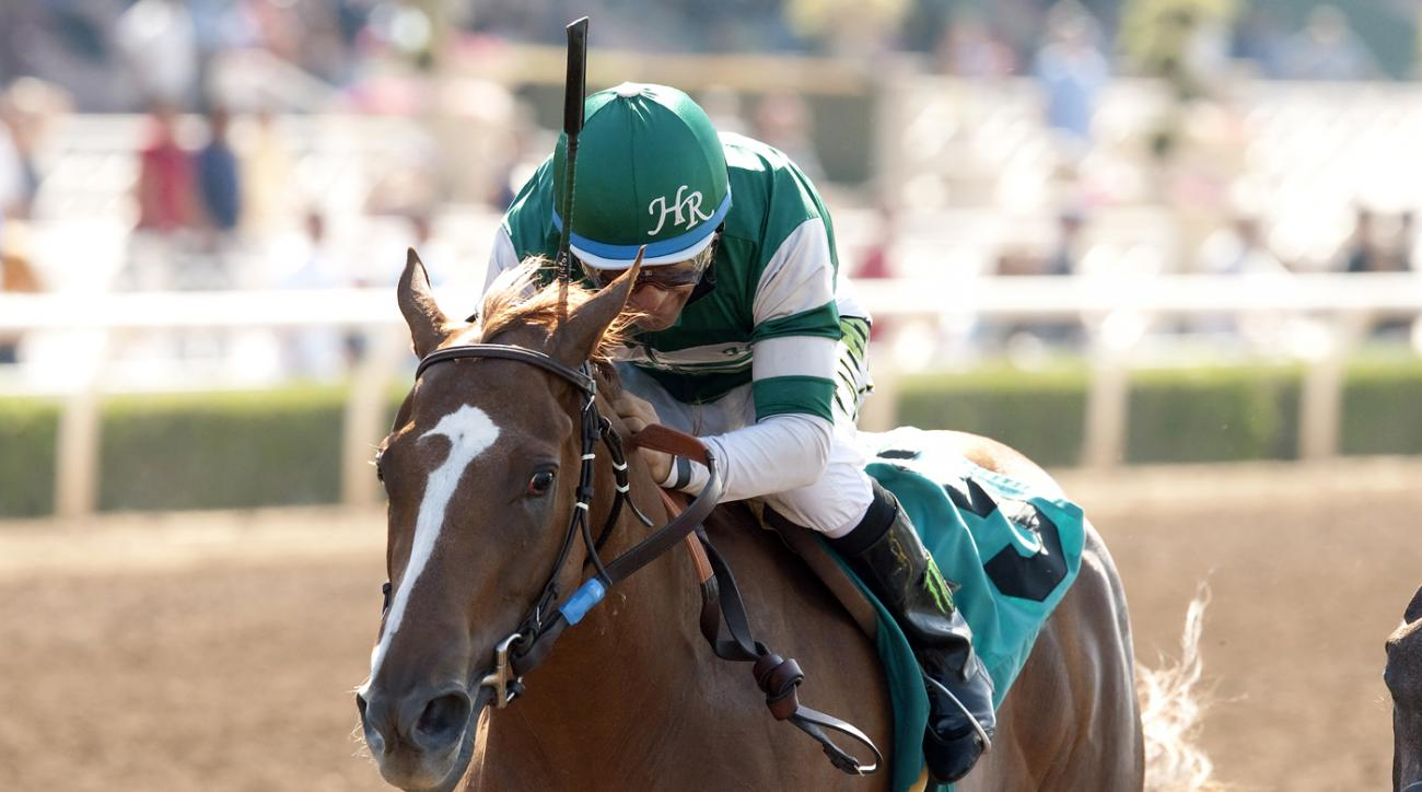 In this image provided by Benoit Photo, Stellar Wind, with Victor Espinoza aboard, wins the Grade II $200,000 Summertime Oaks horse race Saturday, June 20, 2015, at Santa Anita Park in Arcadia, Calif. (Benoit Photo via AP)