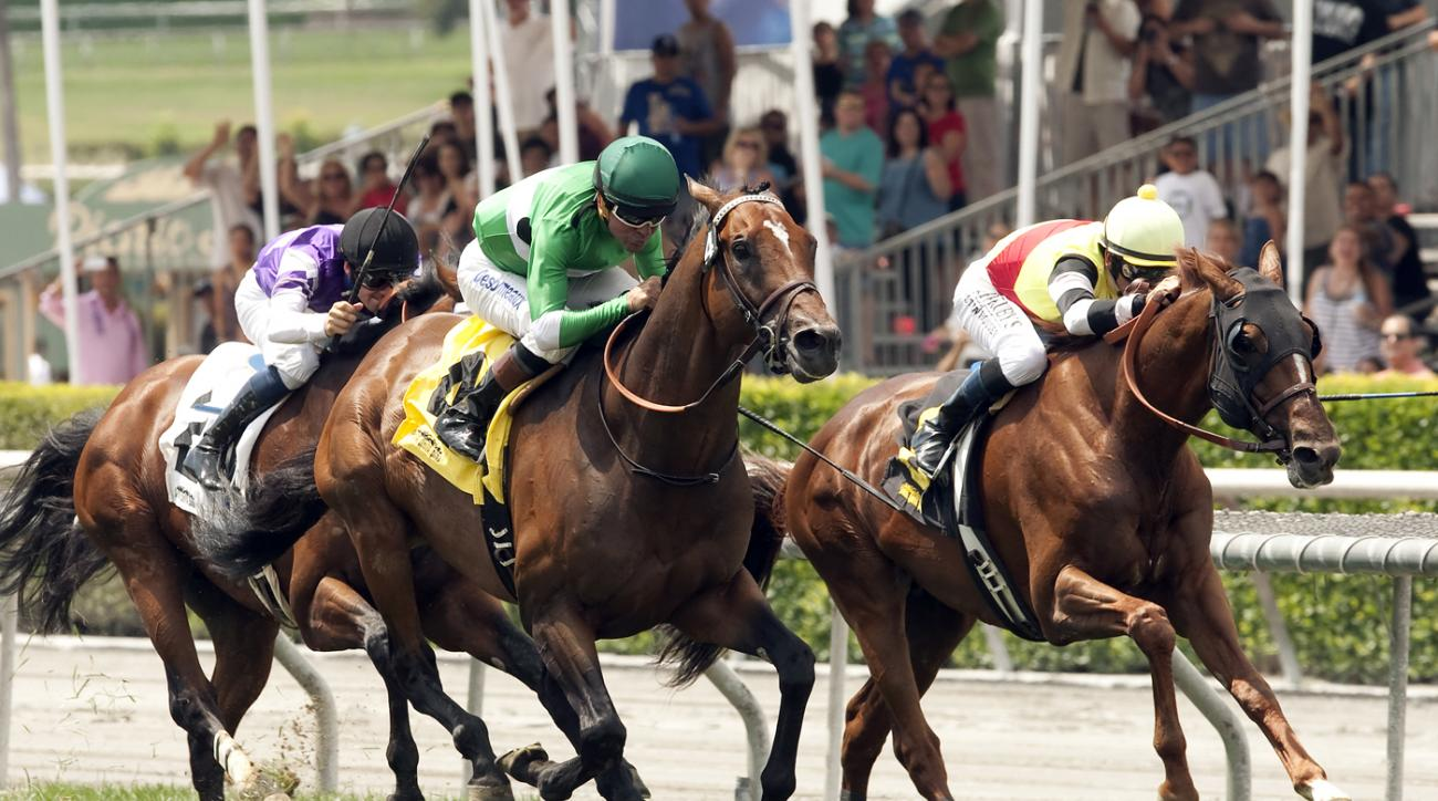 In a photo provided by Benoit Photo, Curcero and jockey Kent Desormeaux, center, moves up to win the Grade III $150,000 San Juan Capistrano Stakes Sunday,  June 28, 2015, at Santa Anita Park, Arcadia, Calif.  (Benoit Photo via AP)