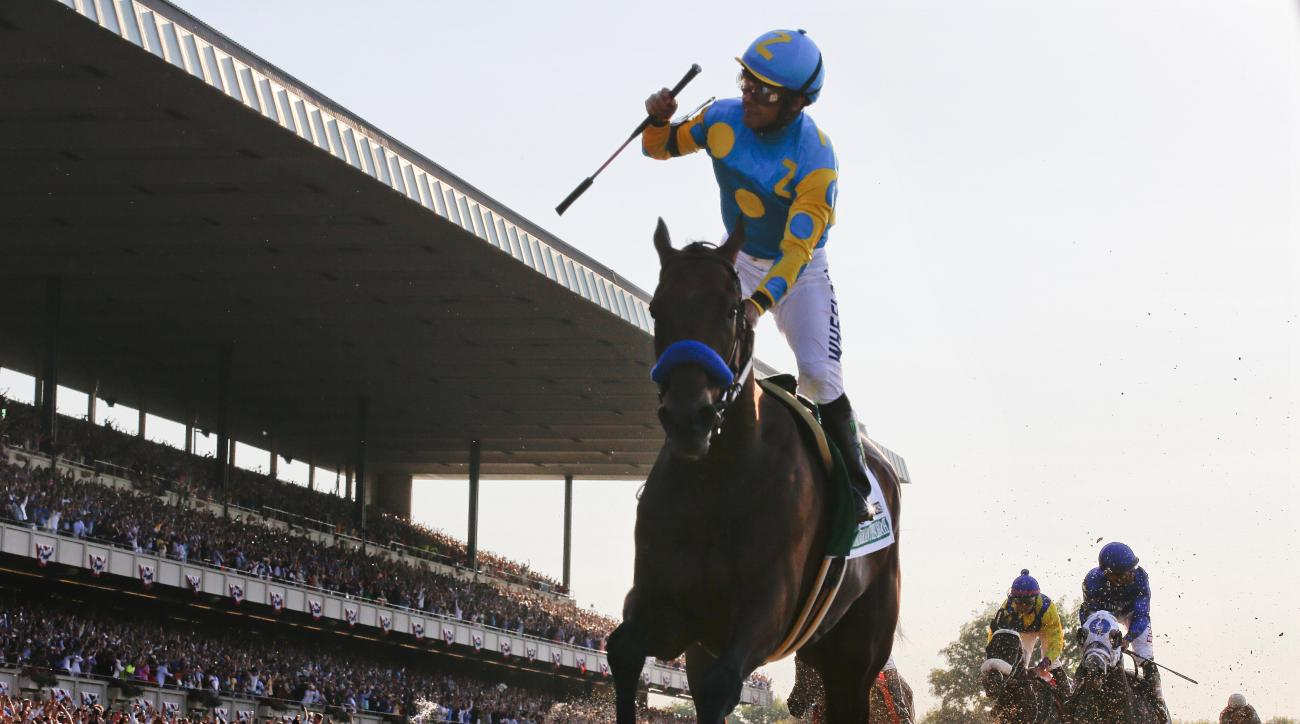 FILE - In this June 6, 2015, file photo, Victor Espinoza reacts after crossing the finish line with American Pharoah (5) to win the 147th running of the Belmont Stakes horse race at Belmont Park, in Elmont, N.Y. Racing's first Triple Crown winner in 37 ye