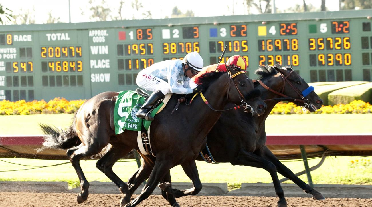 In a photo provided by Benoit Photo, Gimme Da Lute and jockey Martin Garcia, right, outleg Prospect Park, with Tyler Baze, to win the Grade II, $350,000 Los Alamitos Derby horse race, Saturday, July 4, 2015, at Los Alamitos Race Course in Cypress, Calif.