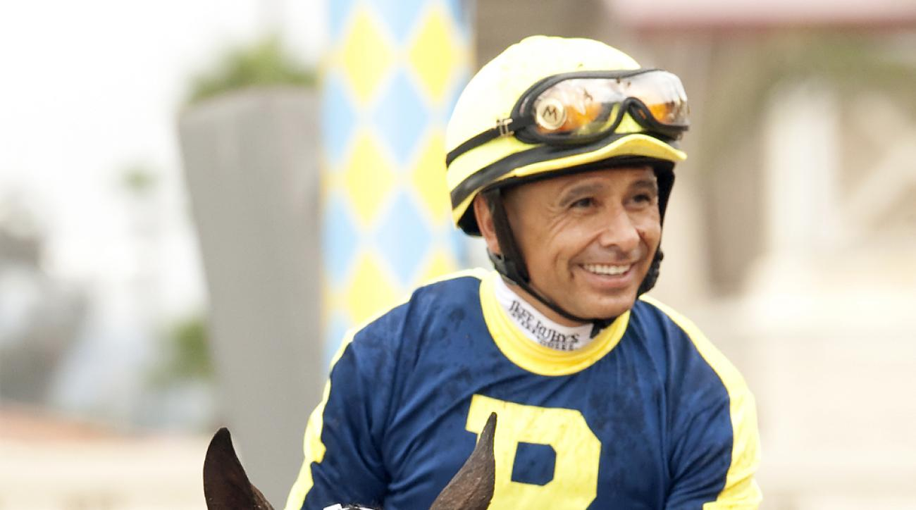In a photo provided by Benoit Photo, jockey Mike Smith guides Gabriel Charles to the winner's circle after their victory in the Grade I, $400,000 Eddie Read Stakes horse race, Saturday, July 18, 2015, at Del Mar Thoroughbred Club in Del Mar, Calif. (Benoi
