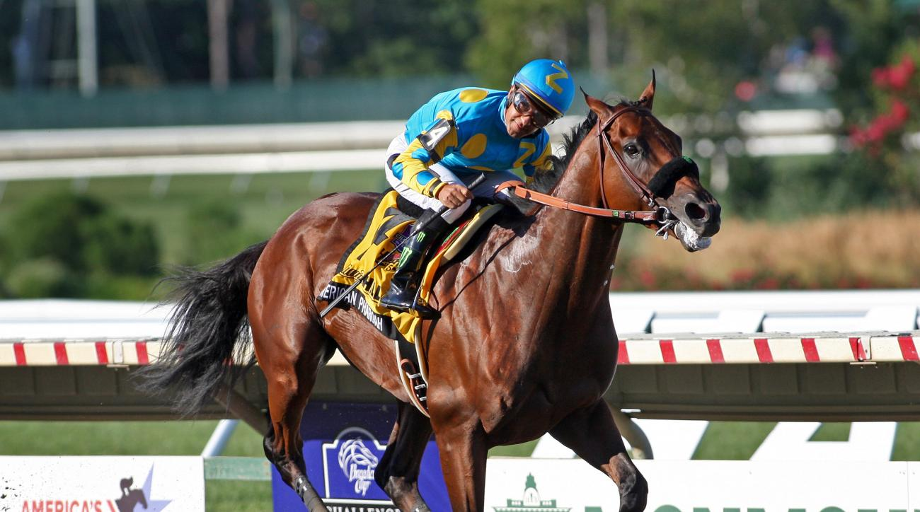 American Pharoah #4 with Victor Espinoza riding, won the $1,750,000 Grade 1 William Hill Haskell Invitational at Monmouth Park in Oceanport, New Jersey on Sunday, Aug. 2, 2015.  (Mark Wyville/EQUI-PHOTO via AP)
