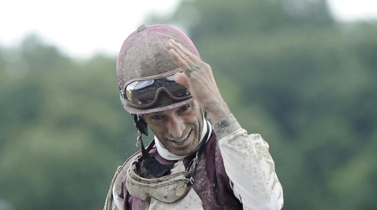FILE - In this July 24, 2015, file photo, jockey John Velazquez celebrates aboard Sea Raven and after winning the first race on opening day of the horse racing season at Saratoga Race Course in Saratoga Springs, N.Y. Velazquez earned his 800th win at Sara
