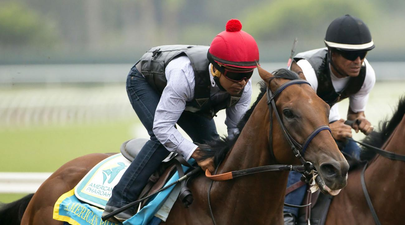 Triple Crown winner American Pharoah and jockey Martin Garcia appear during a workout, Sunday Aug. 23, 2015 at Del Mar Thoroughbred Club in Del Mar, Calif. American Pharoah will run next in the Travers Stakes at a sold-out Saratoga Race Course on Saturday