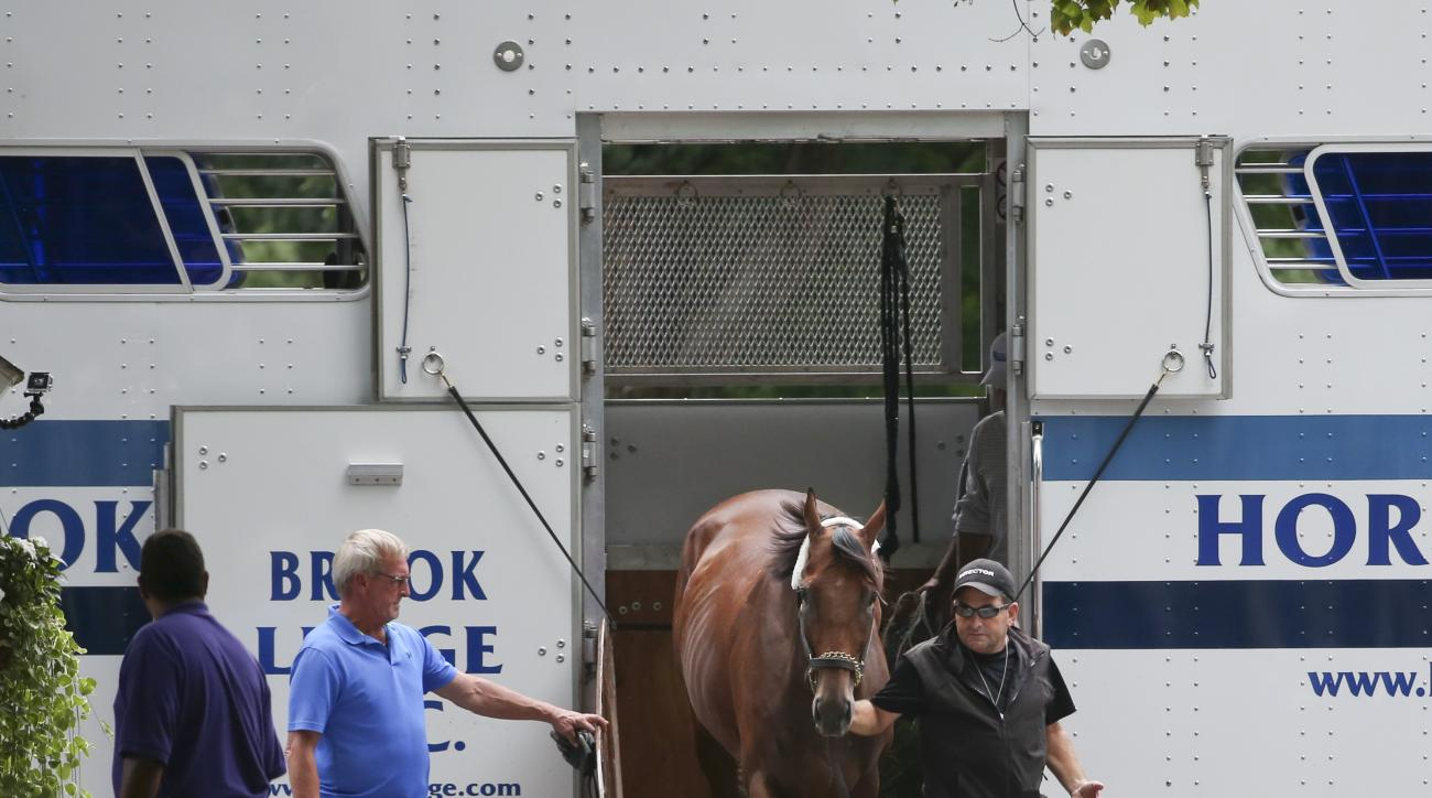 American Pharoah arrives at Saratoga Race Course on Wednesday, Aug. 26, 2015, in Saratoga Springs, N.Y. The Triple Crown winner is the overwhelming 1-5 favorite in a 10-horse field for Saturday's Travers Stakes horse race at Saratoga. (AP Photo/Mike Groll