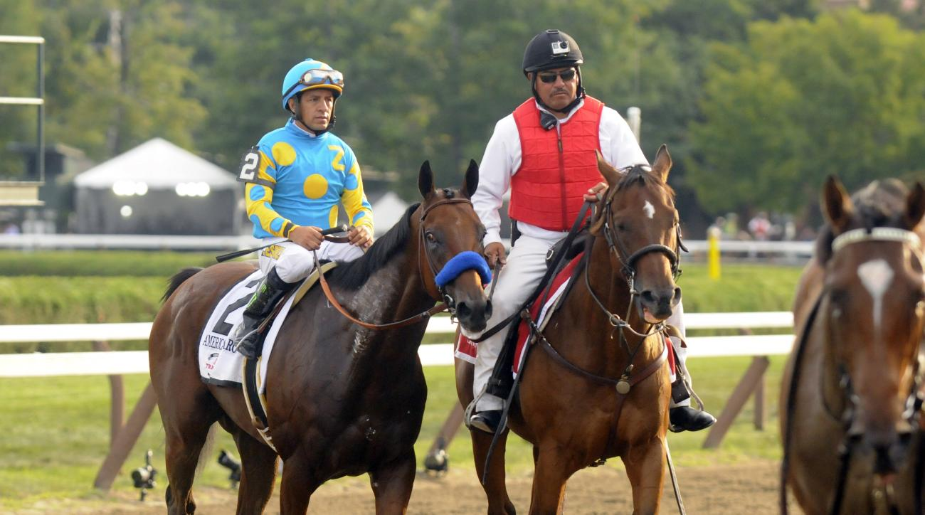 Triple Crown winner American Pharoah (2), with Victor Espinoza is led off the track after losing to Keen Ice in the Travers Stakes horse race at Saratoga Race Course in Saratoga Springs, N.Y., Saturday, Aug. 29, 2015. (AP Photo/Hans Pennink)