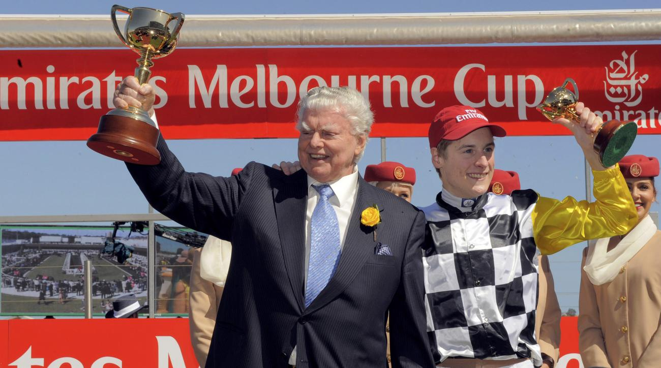 """FILE - In this Nov. 4, 2008, file photo, trainer Bart Cummings, left, holds a Melbourne Cup winner's trophy after jockey Blake Shinn, right, riding """"Viewed"""" won the race at Flemmington race coarse in Melbourne, Australia. Cummings, one of Australia's top"""