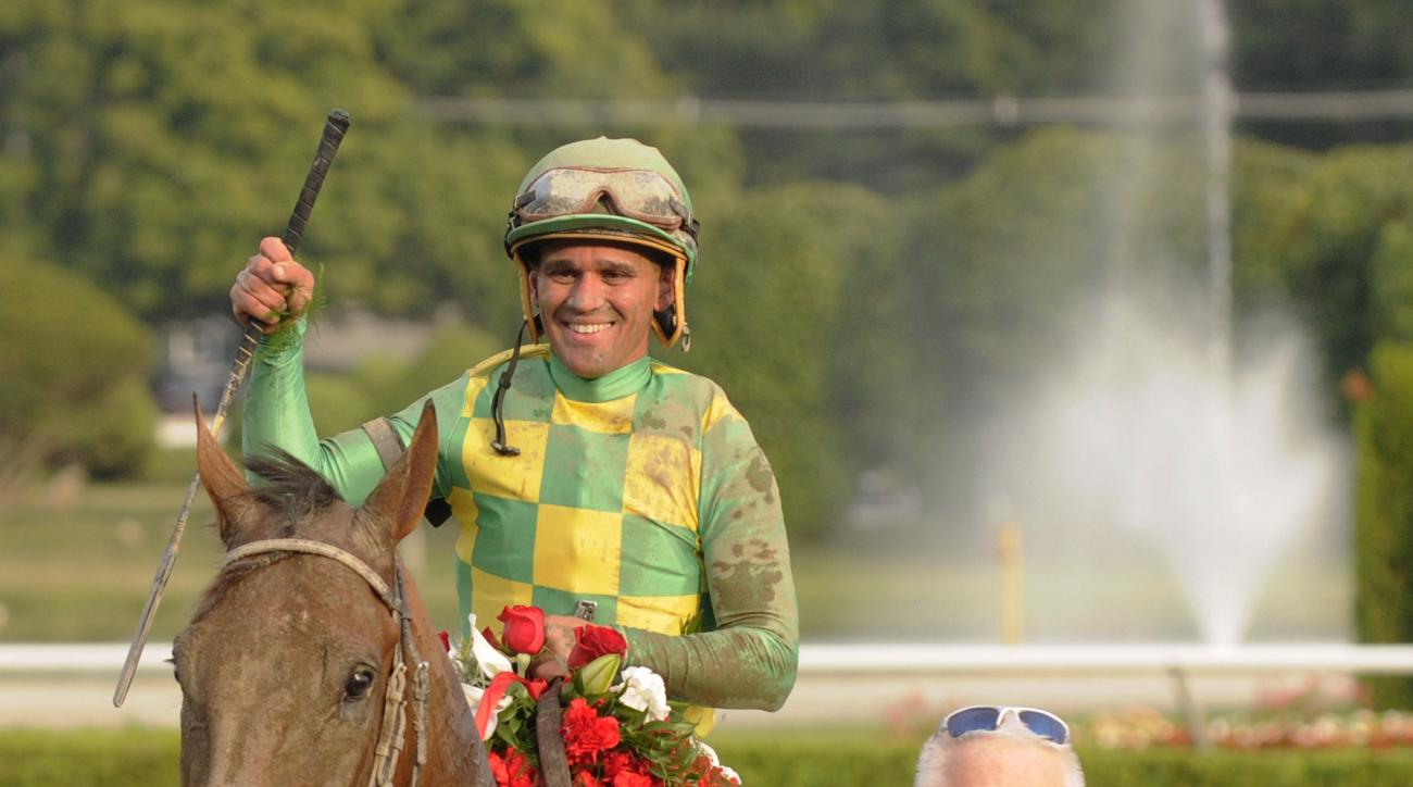FILE - In this Saturday, Aug. 29, 2015 file photo, Keen Ice, with Javier Castellano, heads to the winner's circle after defeating Triple Crown winner American Pharoah to win the Travers Stakes horse race at Saratoga Race Course in Saratoga Springs, N.Y. J