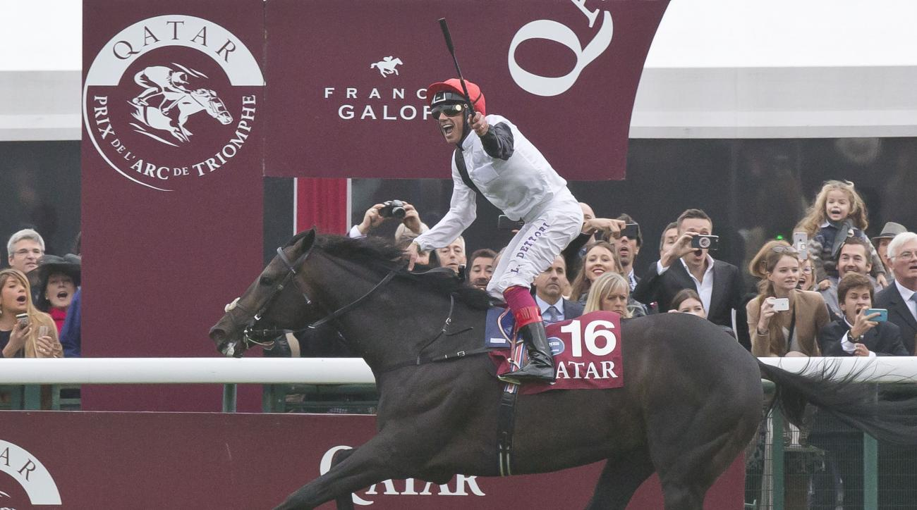 Italian Frankie Dettori riding Golden Horn reacts after crossing the finish line to win the Qatar Prix de l'Arc de Triomphe horse race at the Longchamp horse racetrack, outside Paris, France, Sunday, Oct. 4, 2015. (AP Photo/Michel Euler)