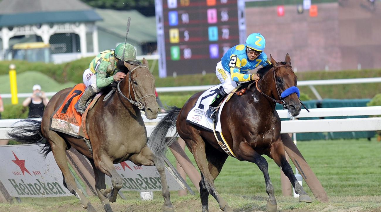 FILE - In this Aug. 29, 2015, file photo, Keen Ice (7) with Javier Castellano up, moves past Triple Crown winner American Pharoah (2), with Victor Espinoza up, to win the Travers Stakes horse race at Saratoga Race Course in Saratoga Springs, N.Y. Triple C