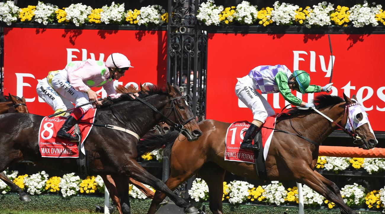 Prince Of Penzance, right with jockey Michelle Payne on board wins the Melbourne Cup, ahead of Max Dynamite ridden by Frankie Dettori, left, at Flemington Racecourse in Melbourne, Australia, Tuesday, Nov. 3, 2015. (AP Photo/Andy Brownbill)