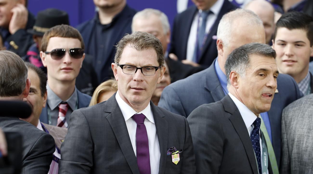 FILE - In this Oct. 30, 2015, file photo, chef Bobby Flay, center, attends the Breeders' Cup horse races at Keeneland race track in Lexington, Ky. Celebrity chef and prominent racehorse owner Bobby Flay has been named to the National Museum of Racing and