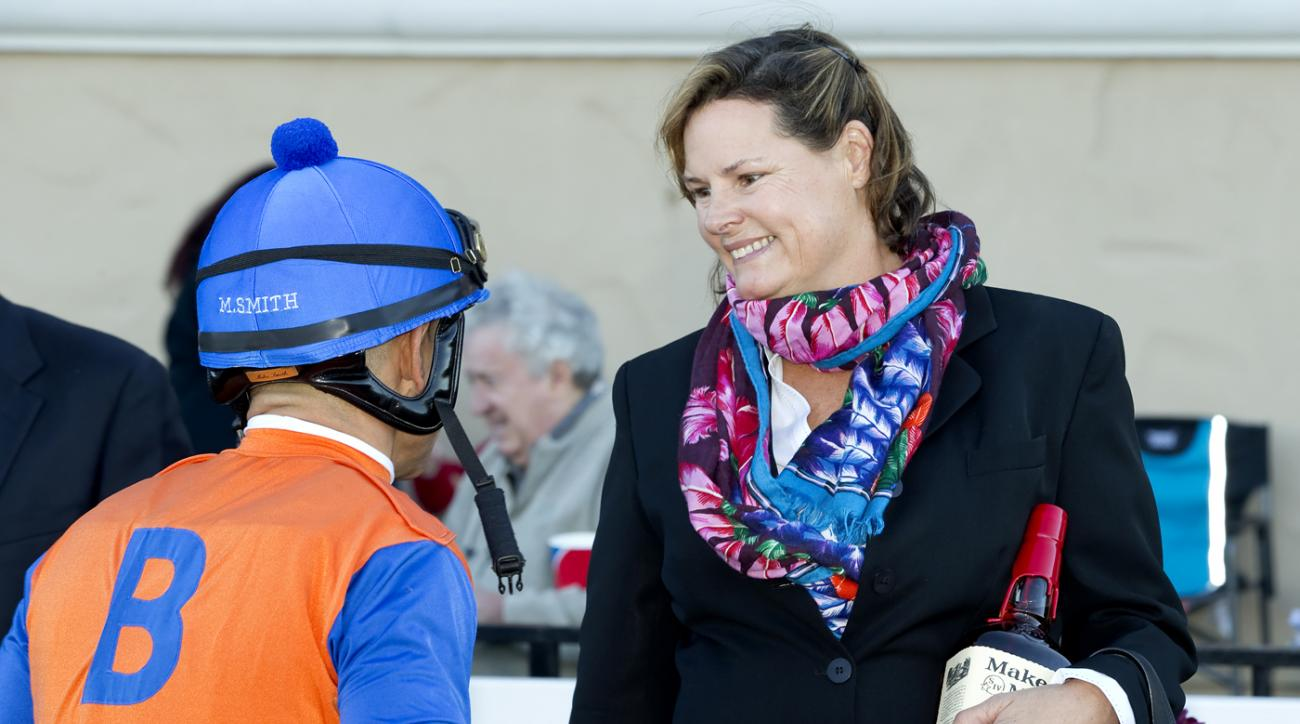 In a photo provided by Benoit Photo, Budget Stable's Dressed In Hermes trainer Janet Armstrong and jockey Mike Smith celebrate winning the Grade III $100,000 Cecil B. DeMille Stakes, Sunday, Nov. 29, 2015 at Del Mar Thoroughbred Club in Del Mar, Calif. (B