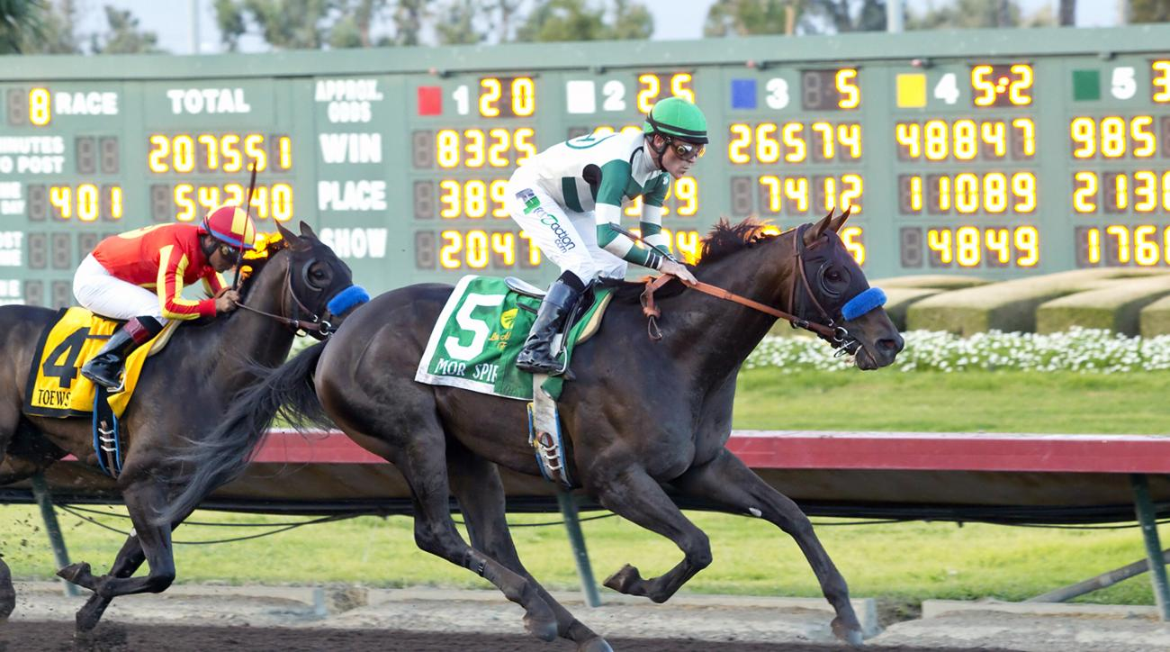 In this image provided by Benoit Photo, Mor Spirit, right, with Gary Stevens aboard, outruns Toews On Ice, with Martin Garcia aboard, to win the Grade I, $350,000 Los Alamitos Futurity horse race, Saturday, Dec. 19, 2015, at Los Alamitos Race Course in Cy