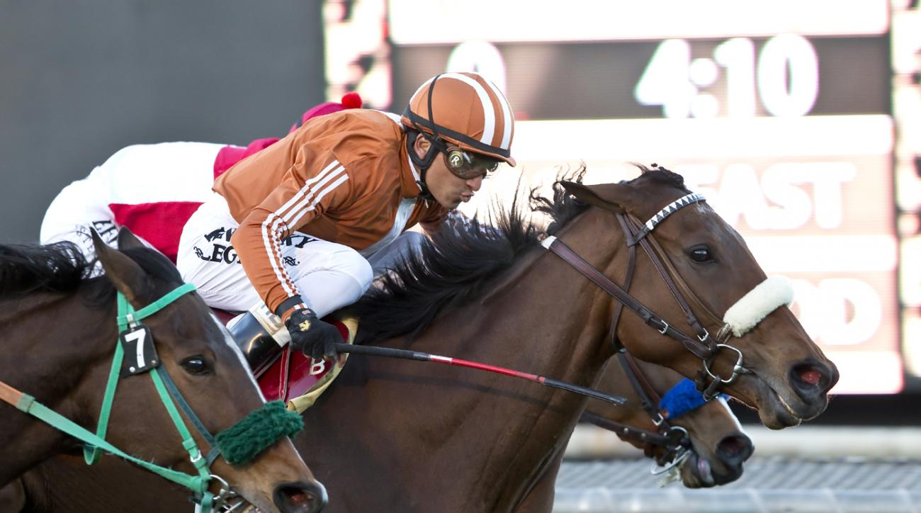 In this image provided by Benoit Photo, Gender Agenda, right, with Rafael Bejarano aboard, splits horses to win the Grade III $100,000 Robert J. Frankel Stakes horse race Sunday, Dec. 27, 2015, at Santa Anita Park in Arcadia, Calif. (Benoit Photo via AP)
