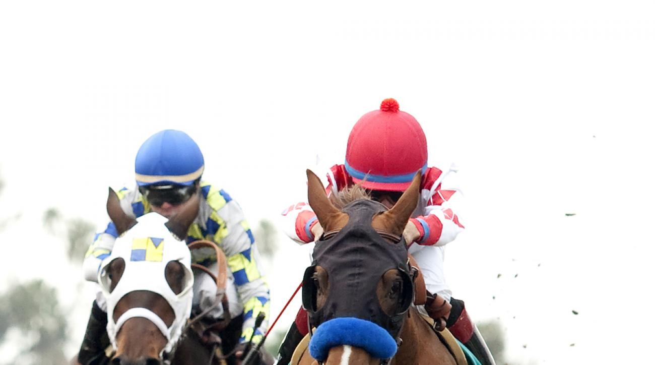 In a photo provided by Benoit Photo, Collected and jockey Martin Garcia, right, outleg Laoban, with Tyler Baze, to win the Grade III, $100,000 Sham Stakes horse race Saturday, Jan. 9, 2016, at Santa Anita in Arcadia, Calif. (Benoit Photo vai AP)