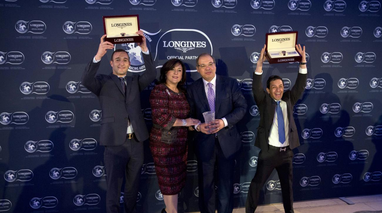 Ahmed Zayat, third left, the owner of the racehorse American Pharoah, his son Justin, left, wife Joanne and Mexican jockey Victor Espinoza pose for photographers after receiving their Longines World's Best Racehorse award for American Pharaoh's achievemen