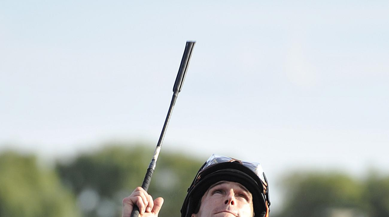 FILE - In this Aug. 18, 2012, file photo, jockey, Ramon A. Dominguez, celebrates aboard Little Mike after winning the Arlington Million horse race at Arlington Park in Arlington Heights, Ill. The National Museum of Racing and Hall of Fame will allow  Domi