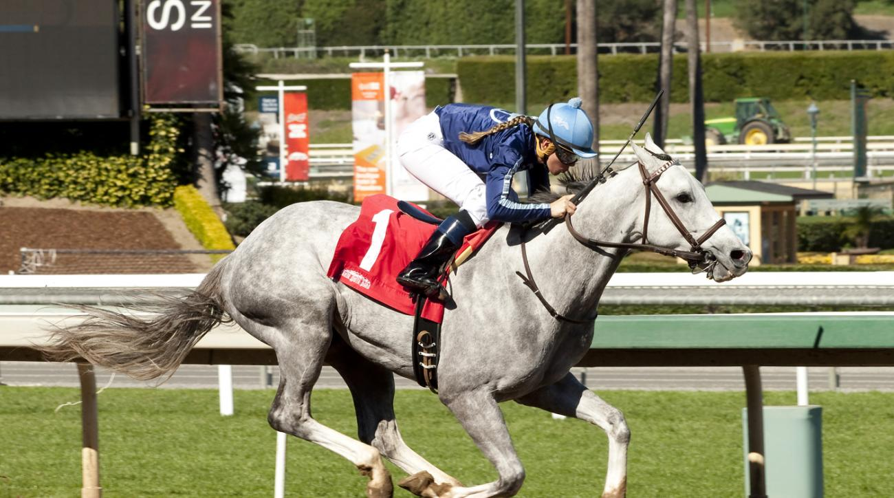 In this image provided by Benoit Photo, apprentice jockey Rosie Higgins on Blue Law competes in a race at Santa Anita Park, Arcadia, Calif., Thursday, Feb. 11, 2016. Higgins rode her first career winner in the second race Thursday at Santa Anita, with Hal