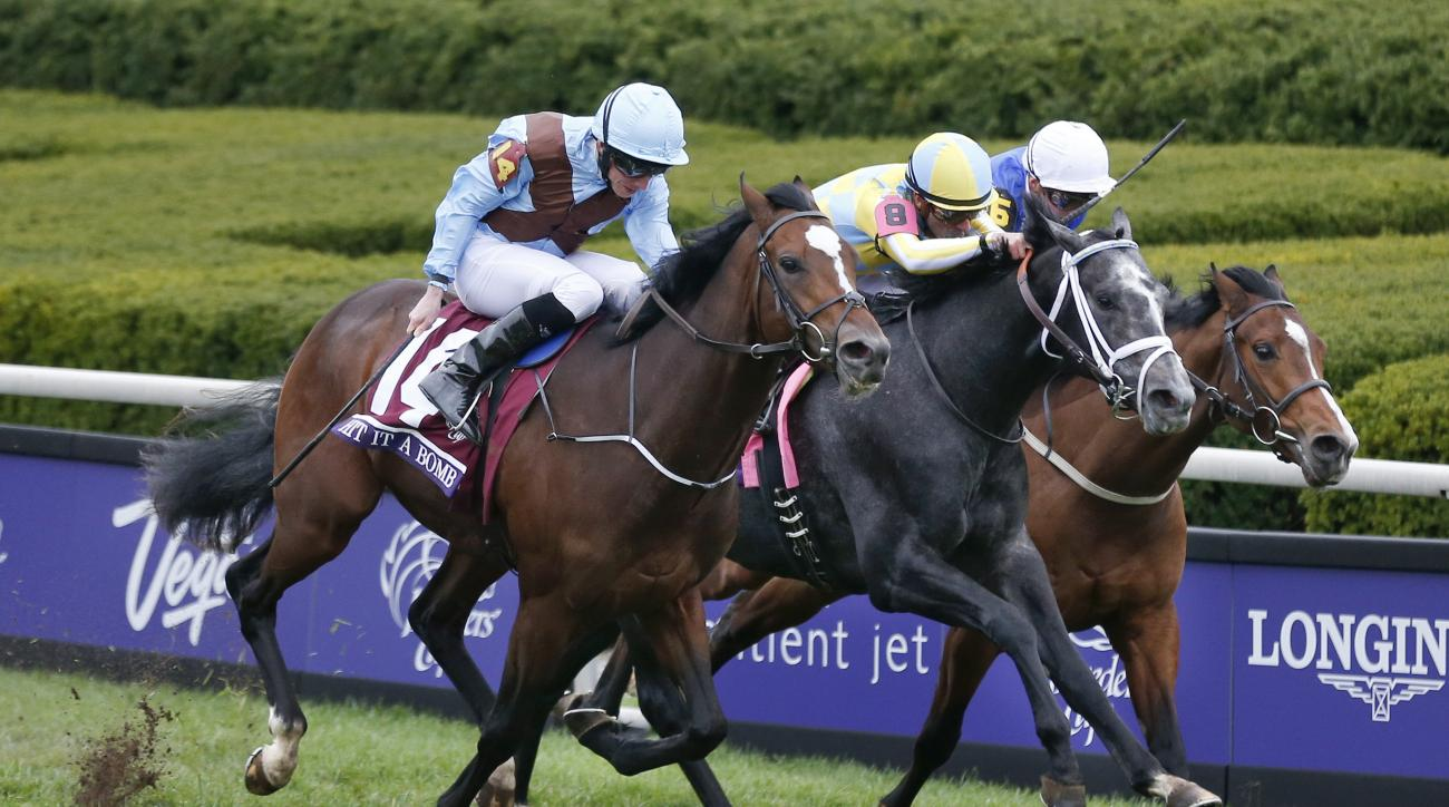 FILE - In this Oct. 30, 2015, file photo, Hit It a Bomb (14), left, with Ryan Moore up, comes down the stretch with Airoforce (8), center, Julien Leparoux up, and Birchwood, right, with James Doyle up, in the Breeders' Cup Juvenile Turf horse race at Keen