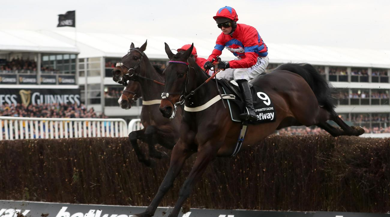 Nico de Boinville  on Sprinter Sacre  clear a fence on the way to winning the  Queen Mother Champion Chase, during  he second day of the 2016 Cheltenham Festival at Cheltenham Racecourse in Cheltenham England Wednesday March 16, 2016. (Mike Egerton/PA via