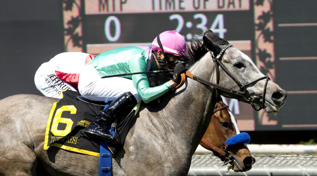 In a photo provided by Benoit Photo, Tuttipaesi, foreground, with jockey Christopher DeCarlo, overpowers Glory, with Mike Smith, to win the Grade II, $200,000 Santa Ana Stakes horse race Saturday, March 26, 2016, at Santa Anita in Arcadia, Calif. (Benoit