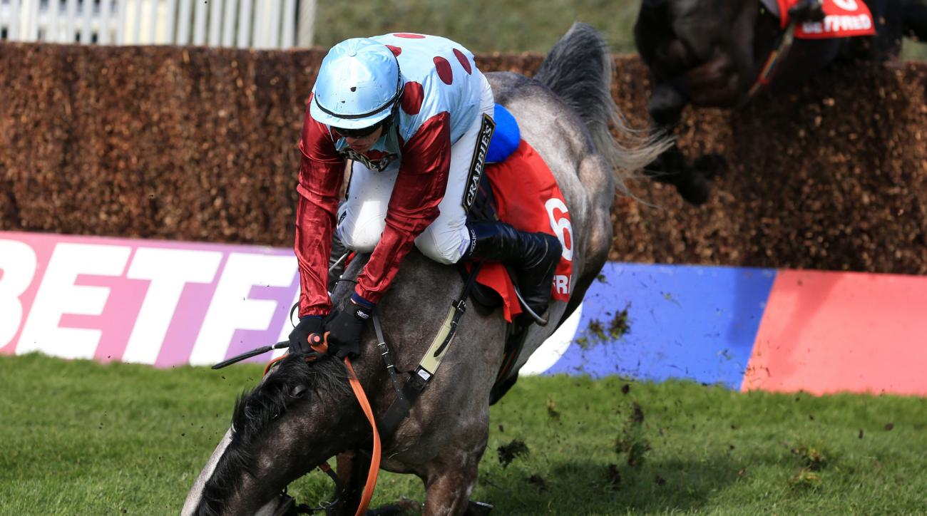 Irish Cavalier ridden by jockey Paul Townend takes a fall during the Betfred Bowl Chase during the Grand Opening Day of the  Grand National Festival at Aintree Racecourse, Liverpool, England Thursday April 7, 2016. (Mike Egerton/PA via AP) UNITED KINGDOM